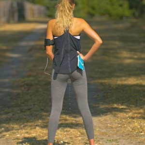 Lady using Tinkle Belle while jogging with carry case