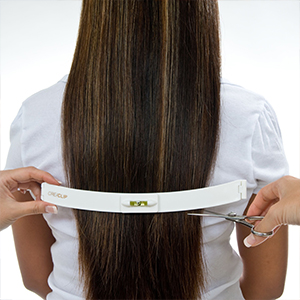 Women getting layered hair cut with CreaClip hair cutting tool