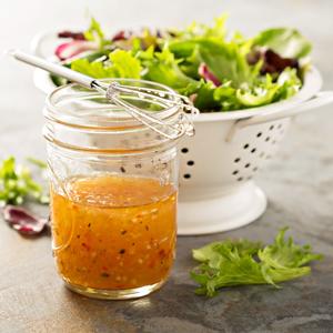 Champagne vinegar in a vinaigrette dressing and salad