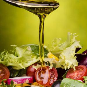 Olive Oil poured on salad