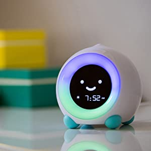 MELLA sleep trainer kid clock with colorful night light on shelf
