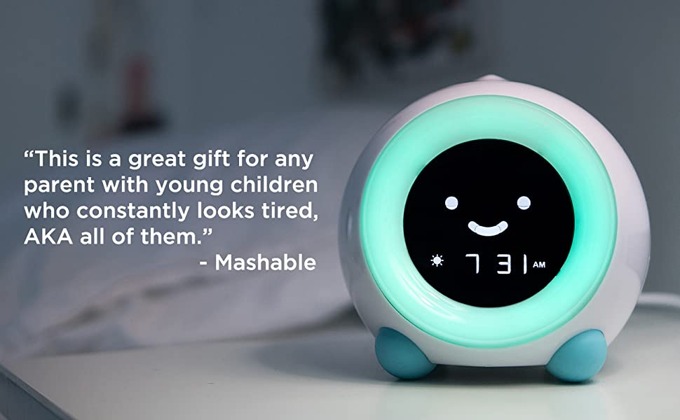 Arctic Blue MELLA ready to rise alarm clock on nightstand in kid's room, with green light
