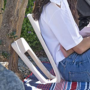 woman rocking outside with portable rocker