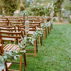 aisles lined with lush eucalyptus garlands