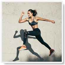 Woman with Elevated Mood and Energy Focused on Running To Help Enhance Her Fitness and Health