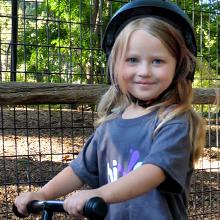 girl having fun on her balance bike