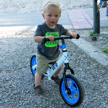 young toddler riding balance bike for the first time