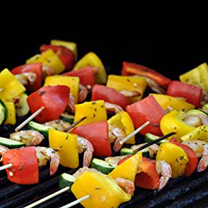 grill charred vegetarian bbq bamboo wooden wood metal skewered open flame cooking camping outdoor