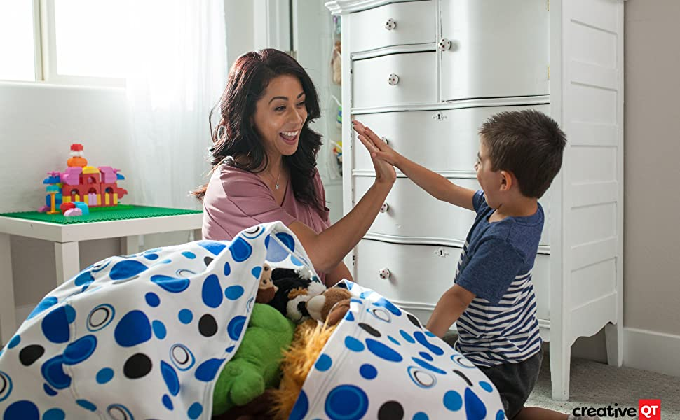 Mom giving her son a high five after finishing filling the Stuff N Sit with stuffed animals together
