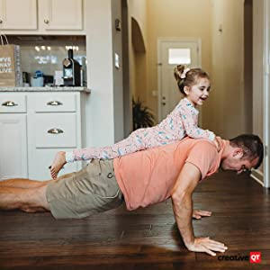 Father and daughter spending time together doing push ups