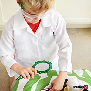 Little boy with magnifying glass and lab coat showing the products are lab tested for safety