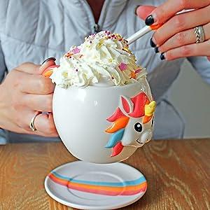 A close up photo of a unicorn coffee mug