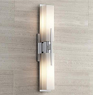 Possini euro design midtown 23 12 high chrome bath light this contemporary bath light features a chrome finish and white glass and can be mounted vertically or horizontally aloadofball Choice Image