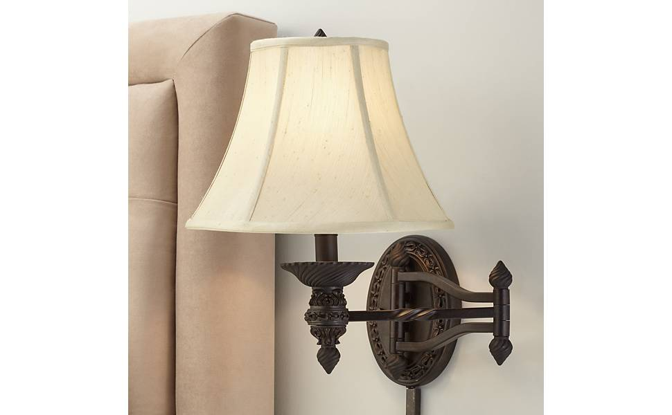 online retailer 0f757 dec05 Godia Bronze Oval Plug-in Swing Arm Wall Lamp - Barnes and Ivy