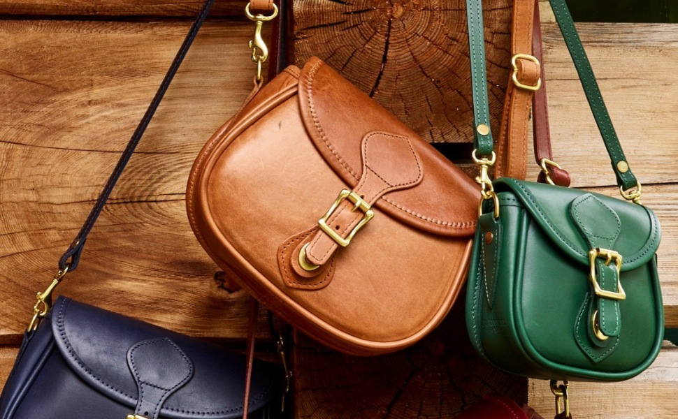 d102cf78d09 This J.W. Hulme classic retains all the fine quality of a leather handbag  from another era. Featured in our exclusive Saddle Heritage leather, ...