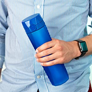 Man holds Royal Blue Hidrate Spark 2.0A smart water bottle while wearing Apple Watch.