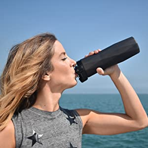 Fitness female drinks from Black Hidrate Spark 2.0A smart water bottle.