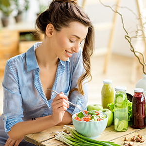 Young woman enjoying a healthy salad.