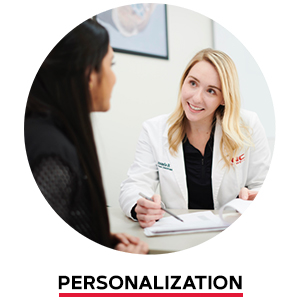 GNC scientist talking with another woman. Personalization.