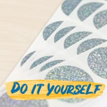 Round, sparkly silver scratch-off stickers with text: Do It Yourself