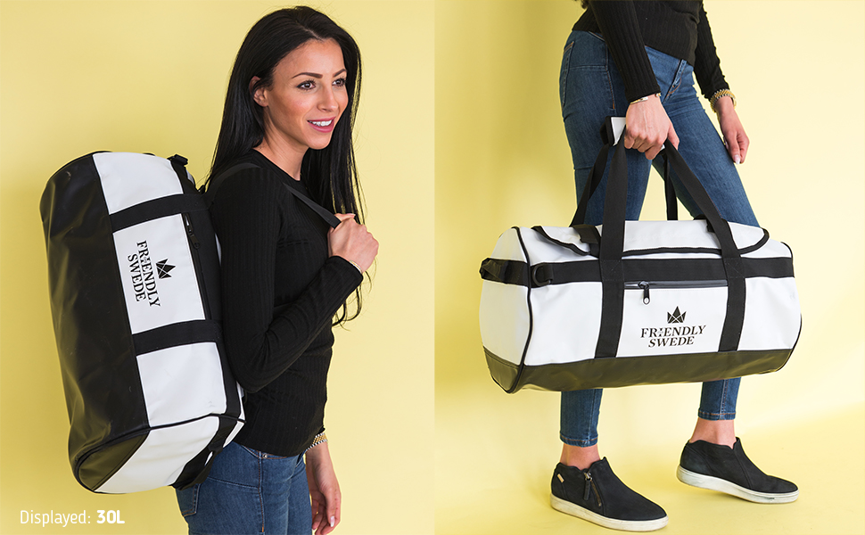 30L duffel bag shown handheld and on shoulder, woman smiling carrying cargo bag