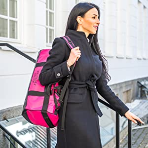 Woman carrying pink 30L duffel