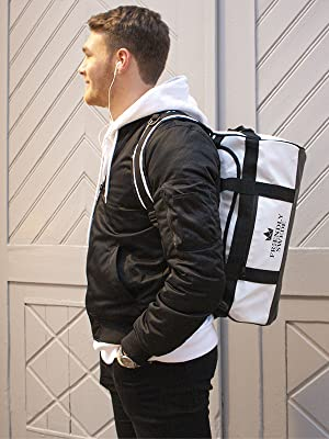 man with duffle backpack on his back