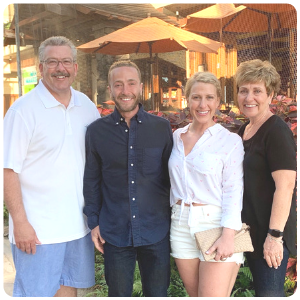 Frank and Nikki, founders of The Ohm Store smiling with their parents