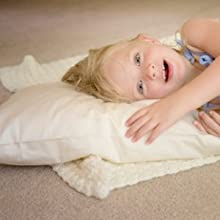 girl playing with toddler pillow
