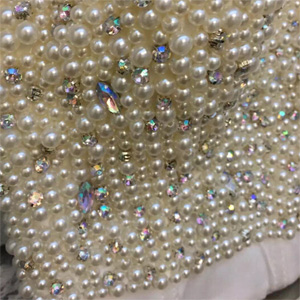 3c0e4c1704 These gogerous shining cropped top are made of high quality hand-made pearls  and diamonds. Superior in material and excellent in workmanship