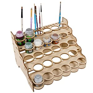 Showing rack with paint pots and brushes