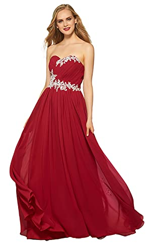 This fashion prom gown features a strapless and sweetheart neckline. The fitted pleated bodice is designed with lace applique for a retro effect.