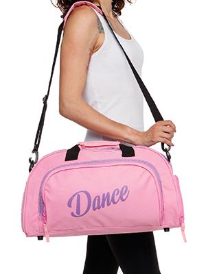 woman holding dance bag