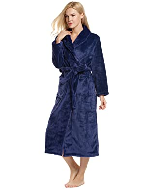 Comfort fleece bathrobe features two large front pockets and a shawl  collar give this robe it s cozy winter cabin feel. fe6b11f3c