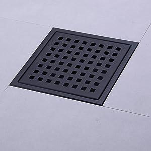 shower floor drain with white tile