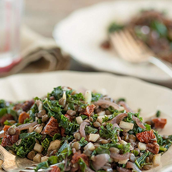 Kale salad with lentils and sun-dried tomatoes.