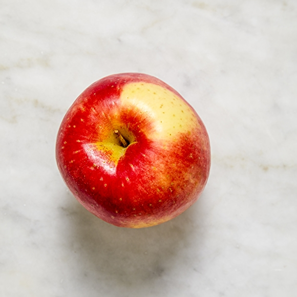 Photo of SweeTango apple on white surface