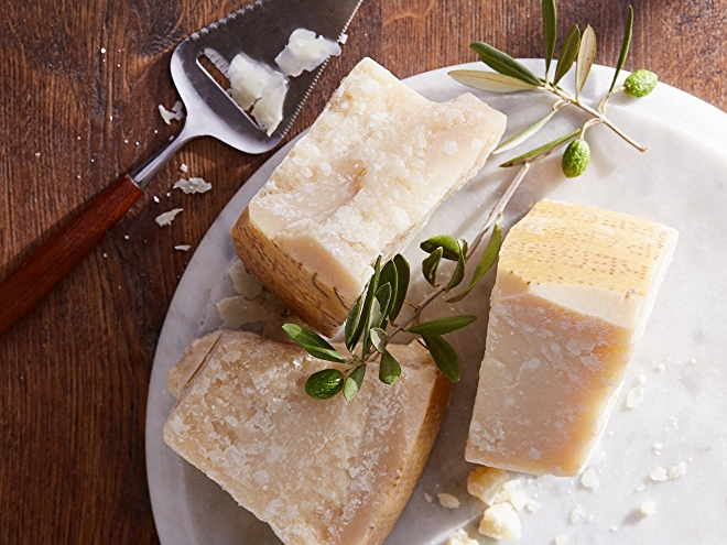 Parmigiano reggiano cheese wedges on plate