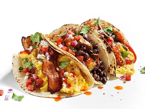 breakfast tacos filled with eggs, bacon, cheese and black beans