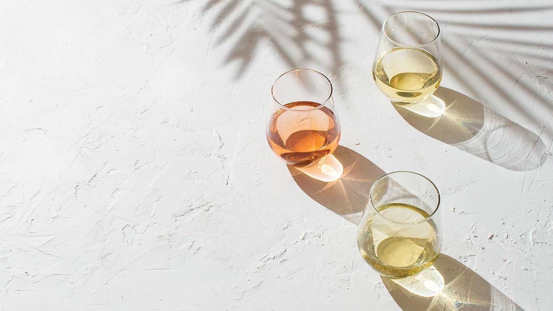 Wine glasses under palm tree