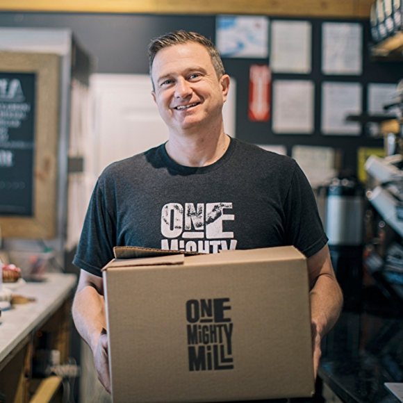 One Mighty Mill owner Jon Olinto holding box