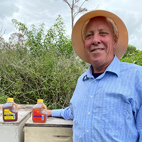 Buzz'n Bee founder David Rukin with honey in field