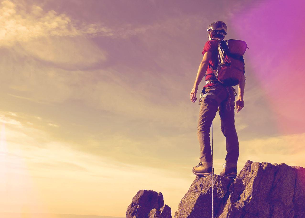 Climber on a mountain peak.