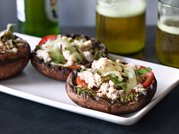 Portobello mushrooms stuffed with cheese, herbs and tomato.