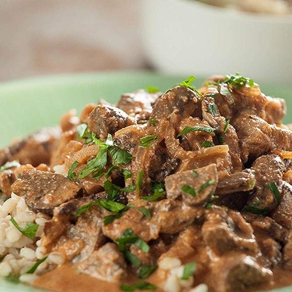 Plate with Mushroom Stroganoff recipe served over rice.