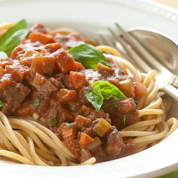 Bowl of eggplant bolognese with spaghetti pasta.