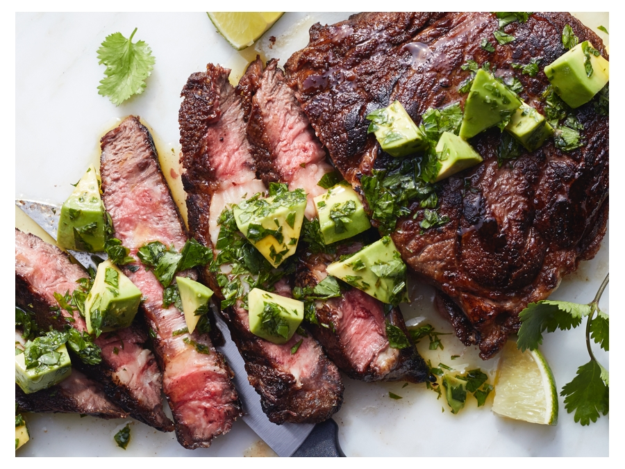 Cooked steak with avocado on top
