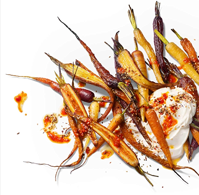 Image of roasted carrots with harissa.