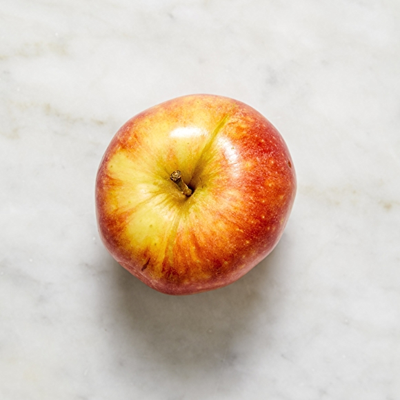 Photo of Gala apple on white surface