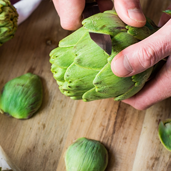 cleaning artichokes with knife